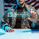 military man in uniform gesturing near cyber security lettering in address bar