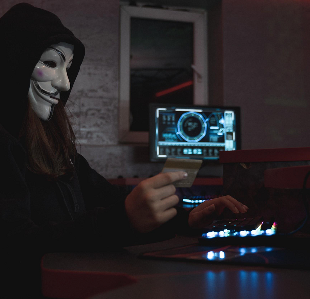 girl hecker in white mask while doing cyber crimes