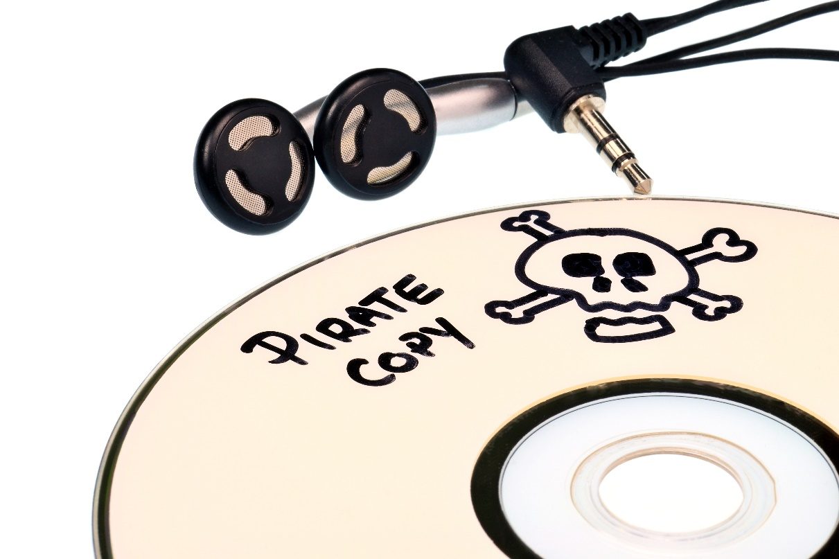 Music piracy with pirate copy cd and headphones