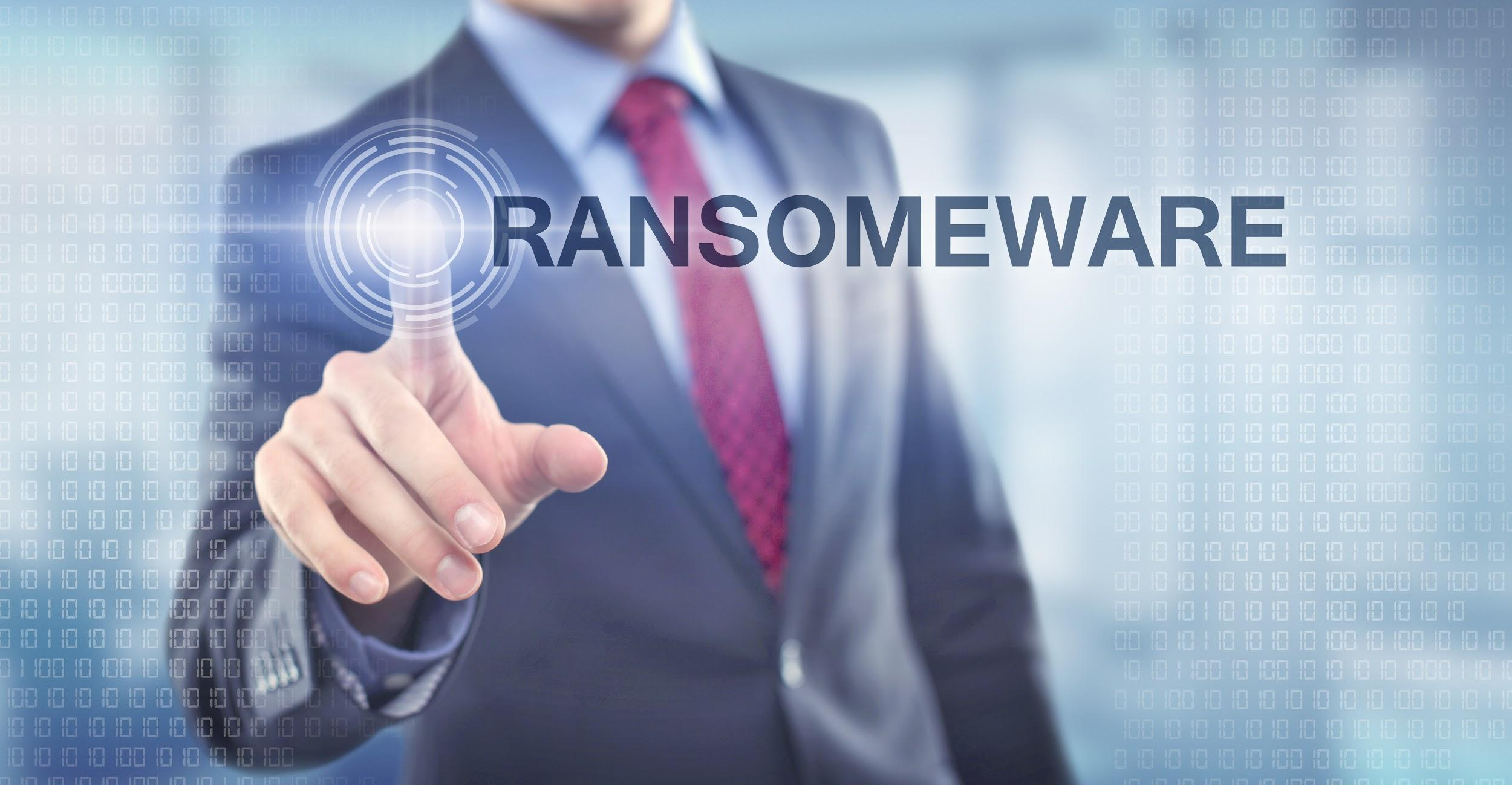 Businessman pressing button on touch screen select Ransomware