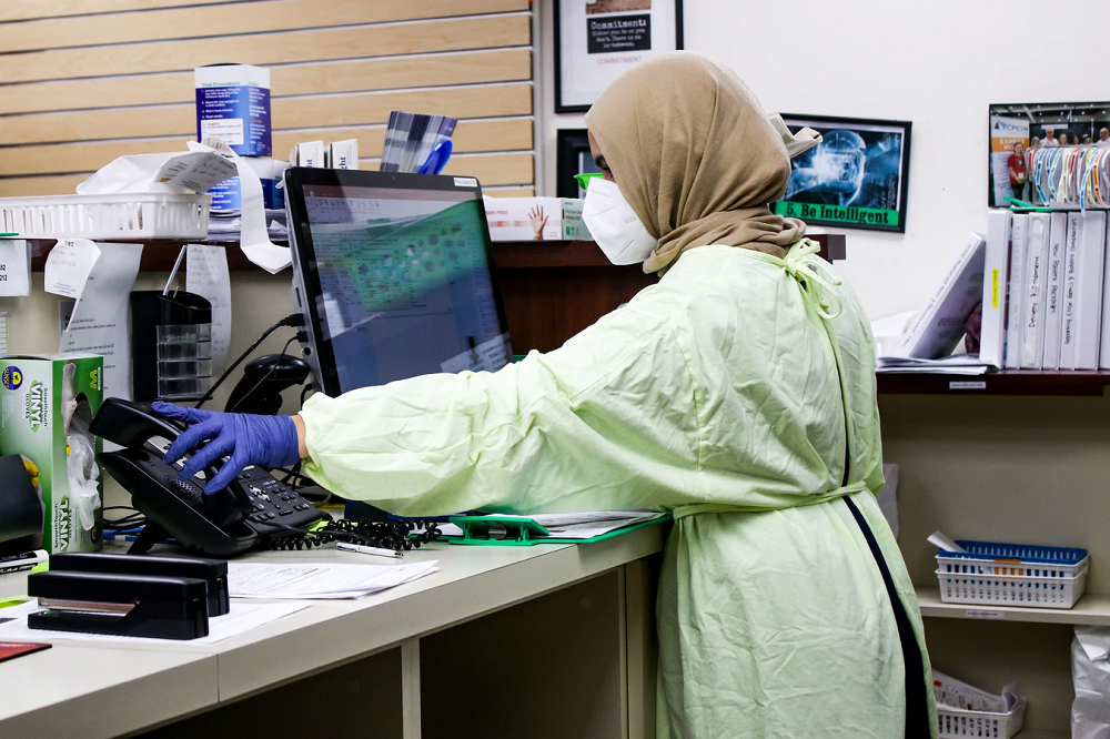 Female scientist in protective workwear work in the lab