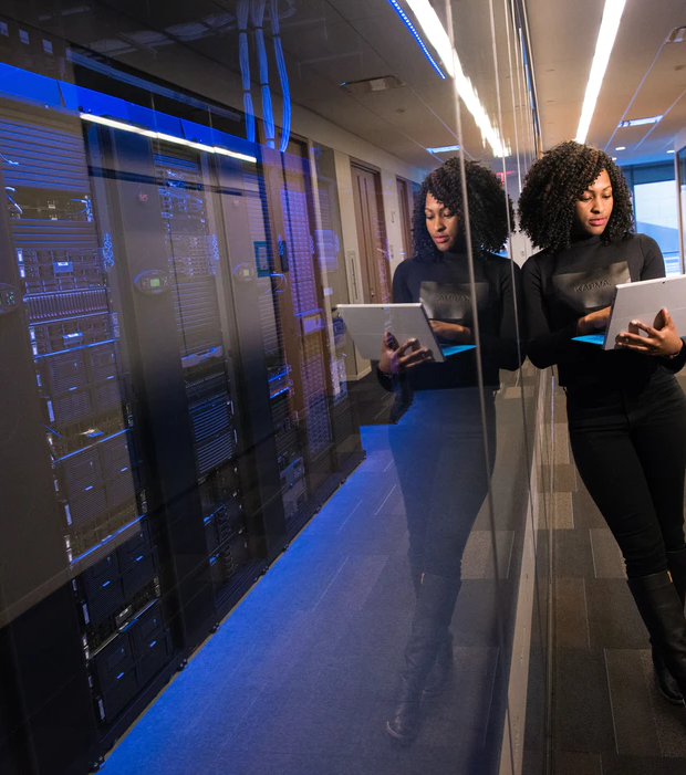 Woman managing a data center from her laptop